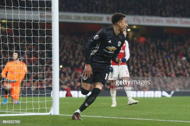 Jesse Lingard of Manchester United celebrates scoring their third goal during the Premier League match between Arsenal and Manchester United at...