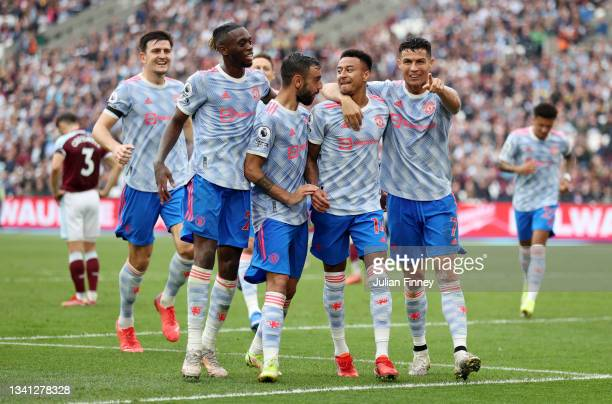 Jesse Lingard of Manchester United celebrates with Aaron Wan-Bissaka, Bruno Fernandes and Cristiano Ronaldo after scoring their team's second goal...