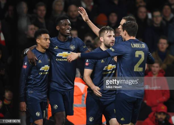 Jesse Lingard of Manchester United celebrates with Paul Pogba and team mates as he scores scores his team's second goal during the FA Cup Fourth...