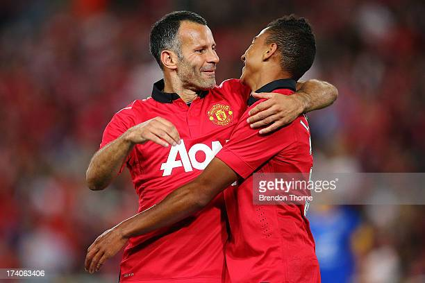 Jesse Lingard of Manchester United celebrates with team mate Ryan Giggs after scoring the opening goal during the match between the ALeague AllStars...