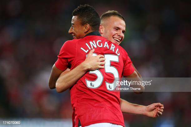 Jesse Lingard of Manchester United celebrates with team mate Tom Cleverley after scoring his second goal during the match between the ALeague...
