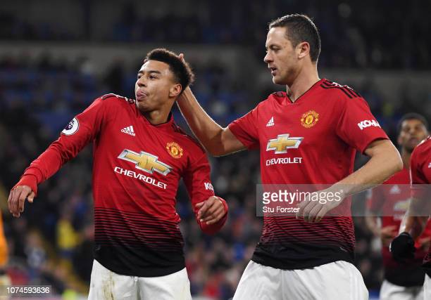 Jesse Lingard of Manchester United celebrates with teammate Ander Herrera after scoring his team's fourth goal during the Premier League match...