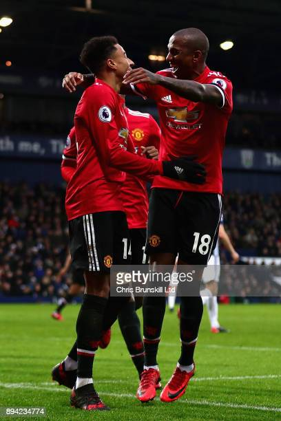 Jesse Lingard of Manchester United celebrates with teammate Ashley Young after scoring his sides second goal during the Premier League match between...