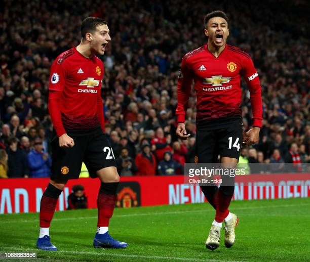 Jesse Lingard of Manchester United celebrates with teammate Diogo Dalot after scoring his team's second goal during the Premier League match between...