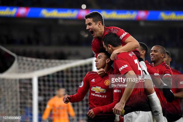 Jesse Lingard of Manchester United celebrates with teammates after scoring his team's fourth goal during the Premier League match between Cardiff...