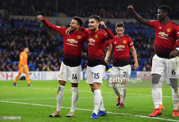 Jesse Lingard of Manchester United celebrates with teammates after scoring his team's fifth goal during the Premier League match between Cardiff City...