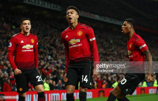Jesse Lingard of Manchester United celebrates with teammates Diogo Dalot and Marcus Rashford after scoring his team's second goal during the Premier...