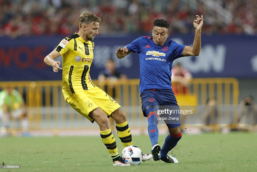 Jesse Lingard (R) of Manchester United competes for the ball with Marcel Schmelzer of Borussia Dortmund during the International Champions Cup match between Manchester United and Borussia Dortmund at Shanghai Stadium on July 22, 2016 in Shanghai, China.