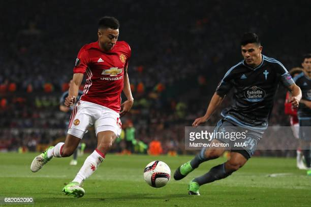 Jesse Lingard of Manchester United competes with Facundo Roncaglia of Celta Vigo during the UEFA Europa League semi final second leg match between...