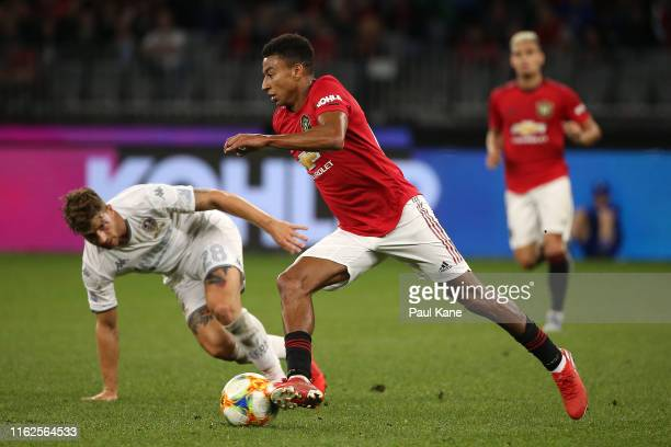 Jesse Lingard of Manchester United controls the ball against Gaetano Berardi of Leeds during a pre-season friendly match between Manchester United...