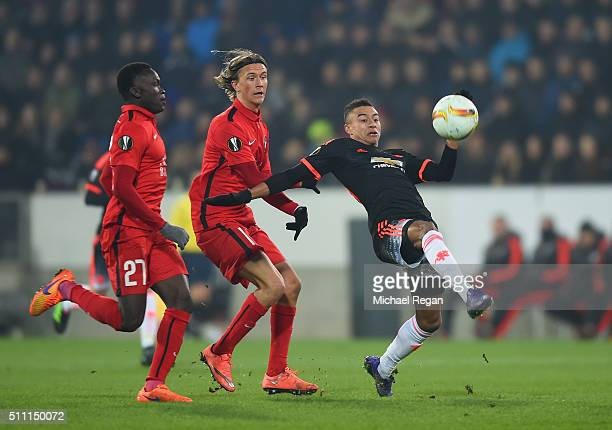 Jesse Lingard of Manchester United controls the ball under pressure of Pione Sisto and Kristoffer Olsson of FC Midtjylland during the UEFA Europa...