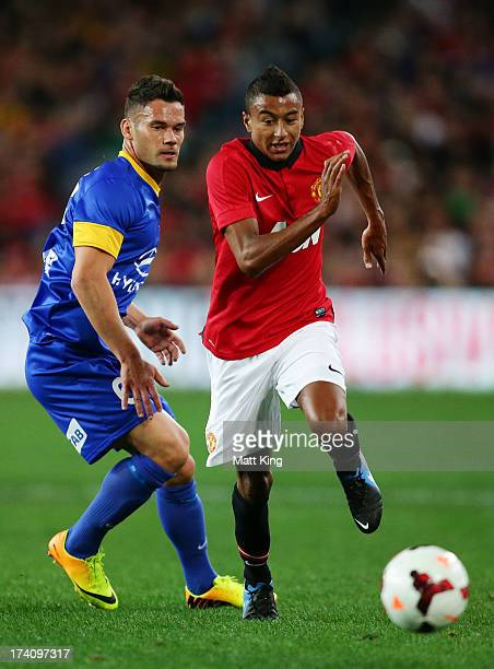 Jesse Lingard of Manchester United gets past Pedj Bojic of the AllStars during the match between the ALeague AllStars and Manchester United at ANZ...