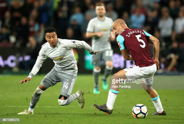 Jesse Lingard of Manchester United goes past Pablo Zabaleta of West Ham United during the Premier League match between West Ham United and Manchester...