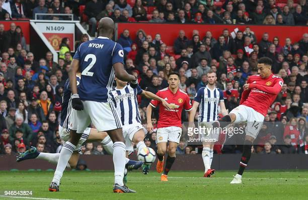 Jesse Lingard of Manchester United has a shot on goal during the Premier League match between Manchester United and West Bromwich Albion at Old...