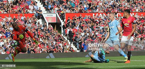 Jesse Lingard of Manchester United has a shot saved by Lee Grant of Stoke City during the Premier League match between Manchester United and Stoke...