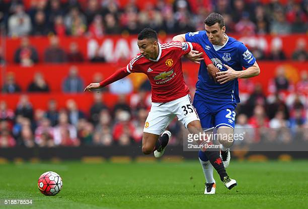 Jesse Lingard of Manchester United holds off Seamus Coleman of Everton during the Barclays Premier League match between Manchester United and Everton...