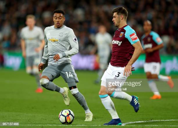 Jesse Lingard of Manchester United in action with Aaron Cresswell of West Ham United during the Premier League match between West Ham United and...