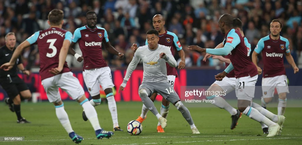Jesse Lingard of Manchester United in action with Aaron Cresswell, Cheikhou Kouyate, Joao Mario, Declan Rice and Angelo Ogbonna of West Ham United during the Premier League match between West Ham United and Manchester United at London Stadium on May 10, 2018 in London, England.
