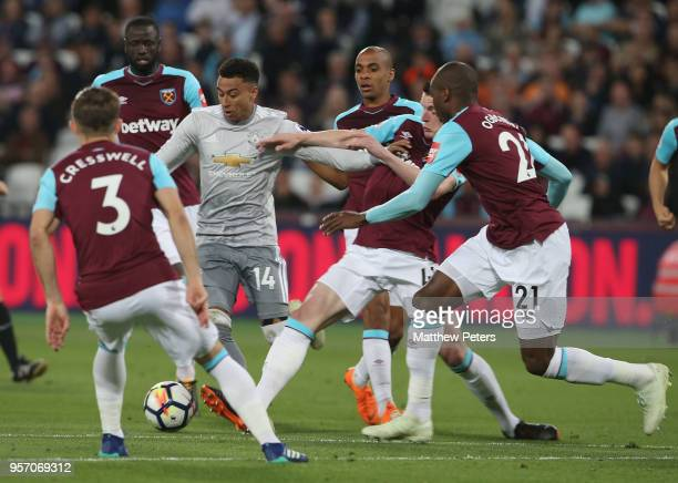 Jesse Lingard of Manchester United in action with Aaron Cresswell Cheikhou Kouyate Joao Mario Declan Rice and Angelo Ogbonna of West Ham United...