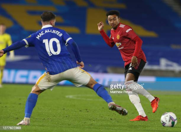 Jesse Lingard of Manchester United in action with Alexis Mac Allister of Brighton and Hove Albion during the Carabao Cup fourth round match between...