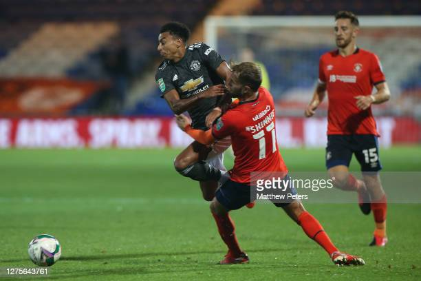 Jesse Lingard of Manchester United in action with Andrew Shinnie of Luton Town during the Carabao Cup Third Round match between Luton Town and...