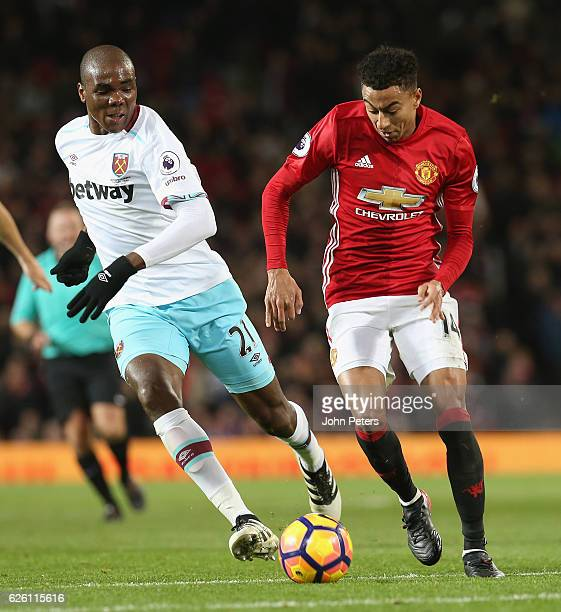 Jesse Lingard of Manchester United in action with Angelo Ogbonna of West Ham United during the Premier League match between Manchester United and...