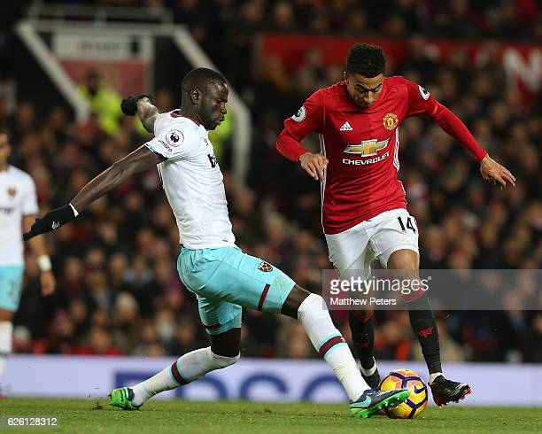 Jesse Lingard of Manchester United in action with Cheikhou Kouyate of West Ham United during the Premier League match between Manchester United and...