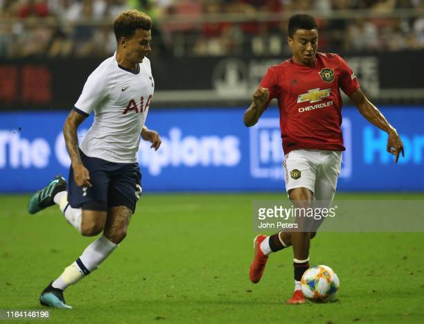 Jesse Lingard of Manchester United in action with Dele Alli of Tottenham Hotspur during the International Champions Cup match between Tottenham...