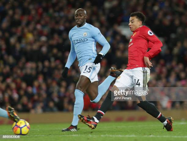 Jesse Lingard of Manchester United in action with Eliaquim Mangala of Manchester City during the Premier League match between Manchester United and...