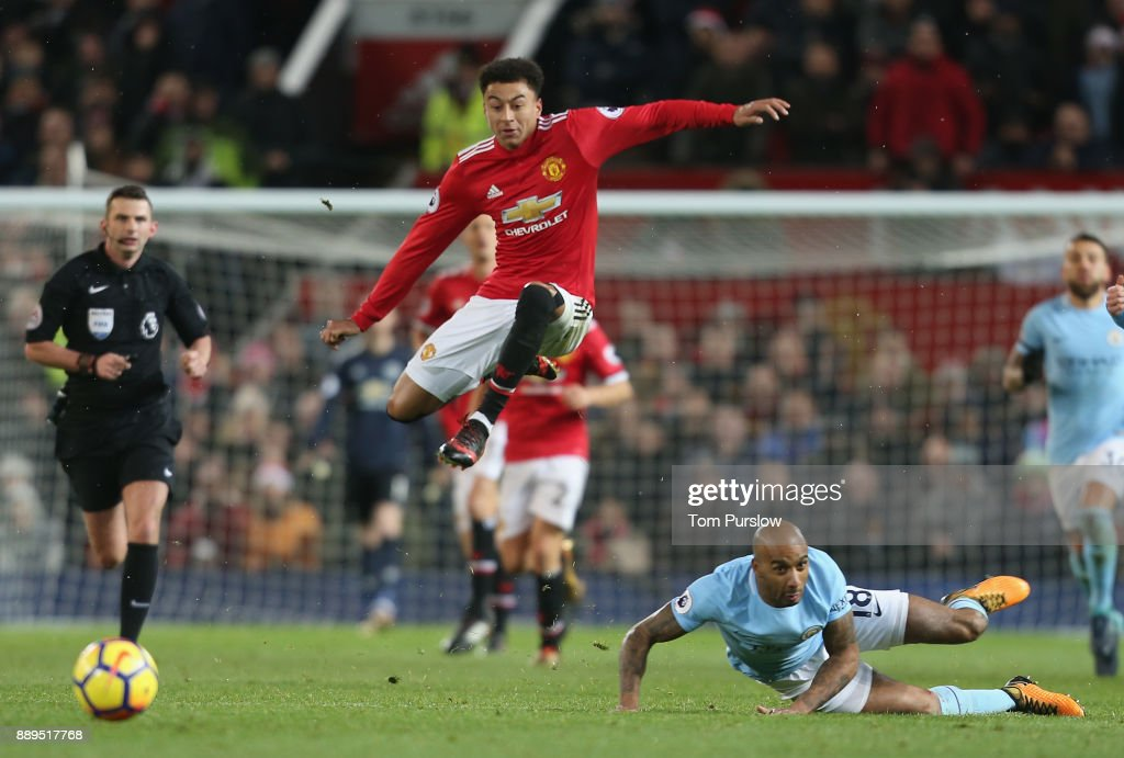 Jesse Lingard of Manchester United in action with Fernandinho of Manchester City during the Premier League match between Manchester United and Manchester City at Old Trafford on December 10, 2017 in Manchester, England.