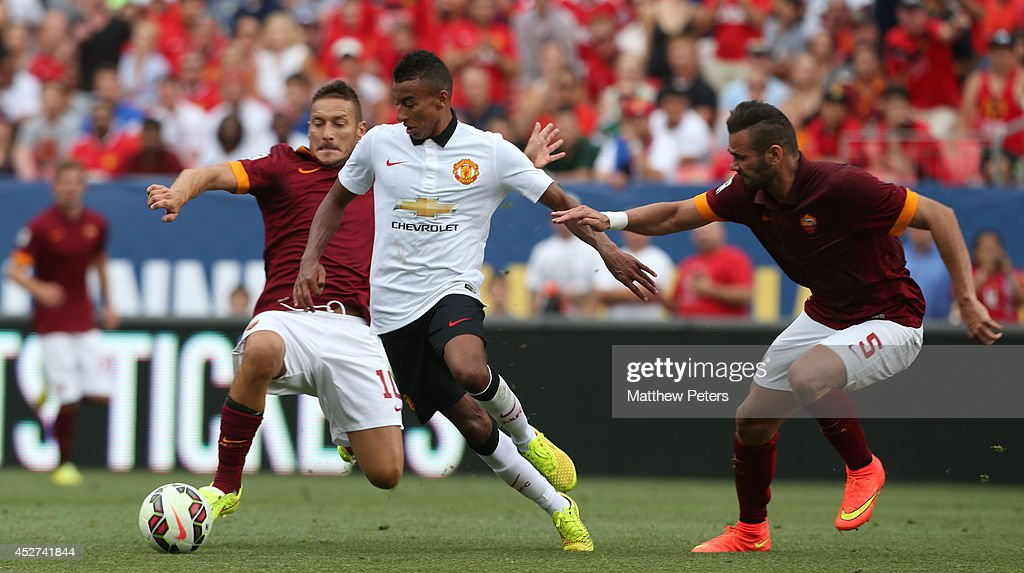 Jesse Lingard of Manchester United in action with Francesco Totti of AS Roma during the pre-season friendly match between Manchester United and AS Roma at Sports Authority Field at Mile High on July 26, 2014 in Denver, Colorado.