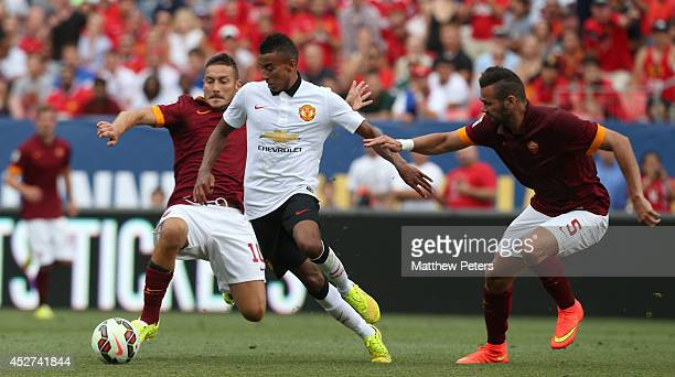 Jesse Lingard of Manchester United in action with Francesco Totti of AS Roma during the preseason friendly match between Manchester United and AS...