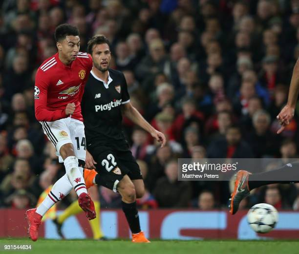 Jesse Lingard of Manchester United in action with Franco Vazquez of Sevilla FC during the UEFA Champions League Round of 16 Second Leg match between...