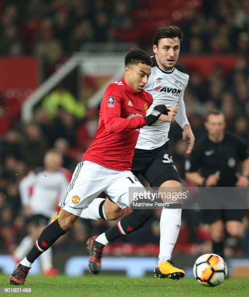 Jesse Lingard of Manchester United in action with George Thorne of Derby County during the Emirates FA Cup Third Round match between Manchester...