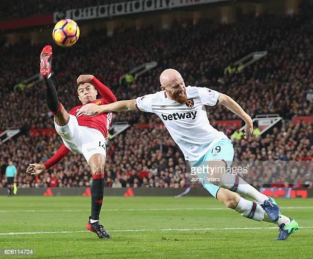 Jesse Lingard of Manchester United in action with James Collins of West Ham United during the Premier League match between Manchester United and West...