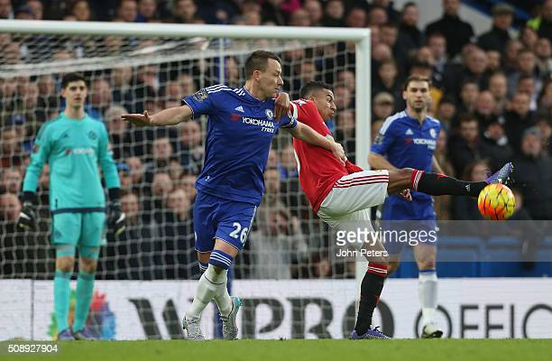 Jesse Lingard of Manchester United in action with John Terry of Chelsea during the Barclays Premier League match between Chelsea and Manchester...