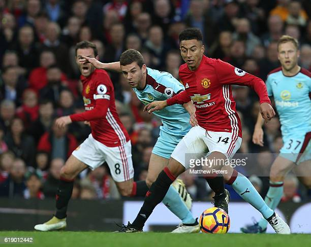 Jesse Lingard of Manchester United in action with Jon Flanagan of Burnley during the Premier League match between Manchester United and Burnley at...