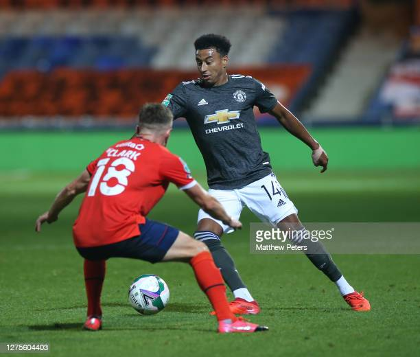 Jesse Lingard of Manchester United in action with Jordan Clark of Luton Town during the Carabao Cup Third Round match between Luton Town and...