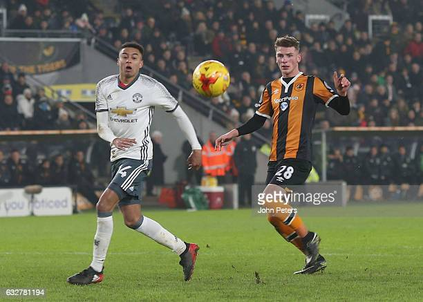 Jesse Lingard of Manchester United in action with Josh Tymon of Hull City during the EFL Cup SemiFinal second leg match between Hull City and...
