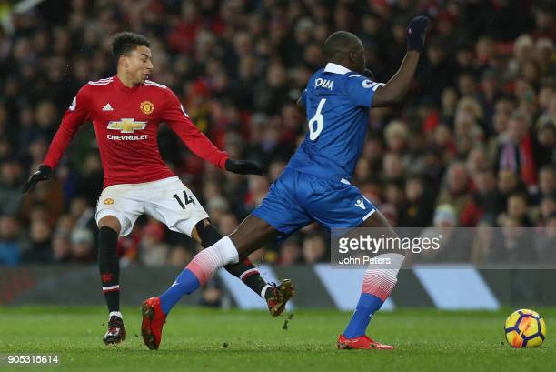Jesse Lingard of Manchester United in action with Kurt Zouma of Stoke City during the Premier League match between Manchester United and Stoke City...
