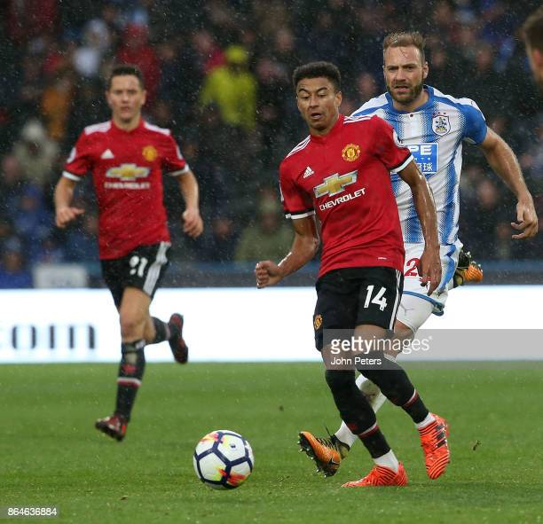 Jesse Lingard of Manchester United in action with Laurent Depoitre of Huddersfield Town during the Premier League match between Huddersfield Town and...