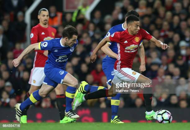 Jesse Lingard of Manchester United in action with Leighton Baines of Everton during the Premier League match between Manchester United and Everton at...
