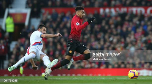 Jesse Lingard of Manchester United in action with Luka Milivojevic of Crystal Palace during the Premier League match between Manchester United and...