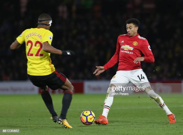 Jesse Lingard of Manchester United in action with Marvin Zeegelaar of Watford during the Premier League match between Watford and Manchester United...
