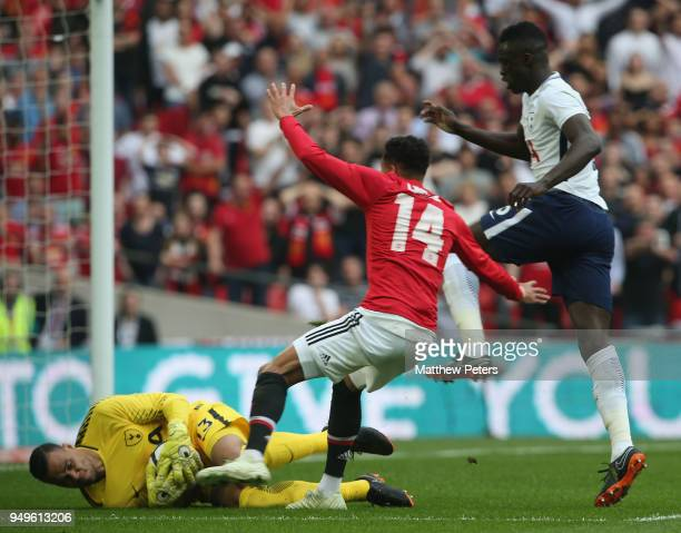 Jesse Lingard of Manchester United in action with Michel Vorm of Tottenham Hotspur during the Emirates FA Cup semifinal match between Manchester...