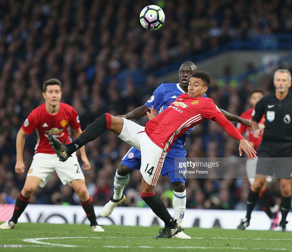 Jesse Lingard of Manchester United in action with Ngolo Kante of Chelsea during the Barclays Premier League match between Chelsea and Manchester United at Stamford Bridge on October 23, 2016 in London, England.