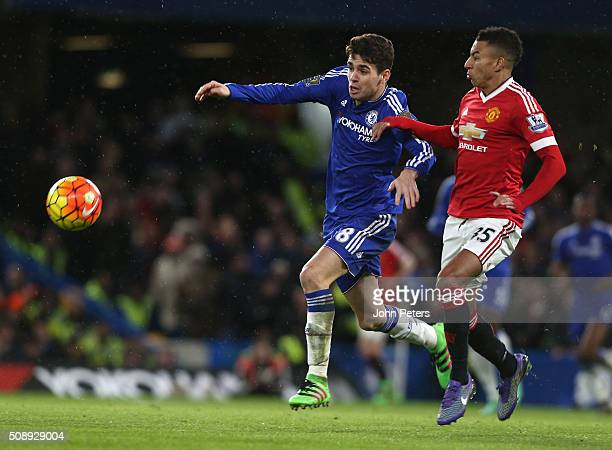 Jesse Lingard of Manchester United in action with Oscar of Chelsea during the Barclays Premier League match between Chelsea and Manchester United at...