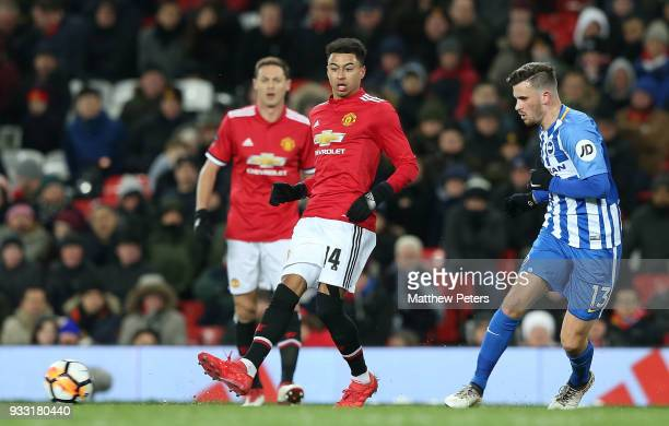 Jesse Lingard of Manchester United in action with Pascal Gross of Brighton Hove Albion during the Emirates FA Cup Quarter Final match between...