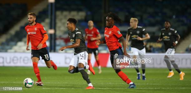 Jesse Lingard of Manchester United in action with Peter Kioso of Luton Town during the Carabao Cup Third Round match between Luton Town and...