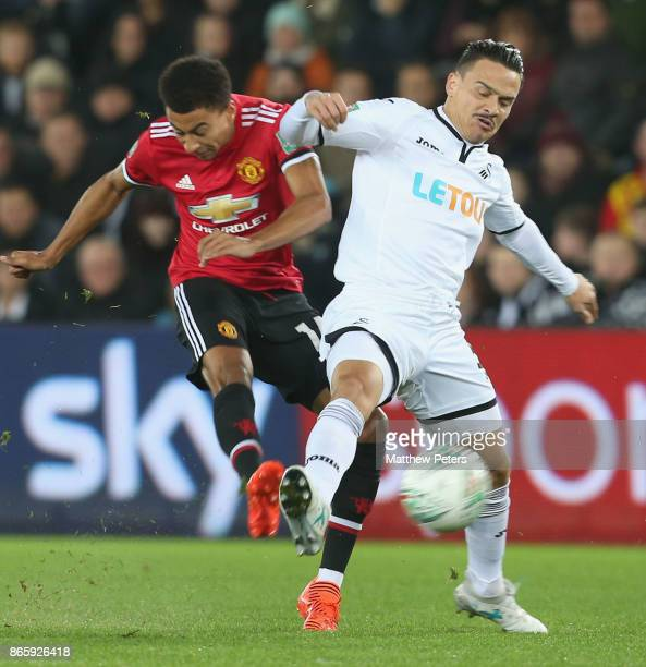 Jesse Lingard of Manchester United in action with Roque Mesa of Swansea City during the Carabao Cup Fourth Round match between Swansea City and...